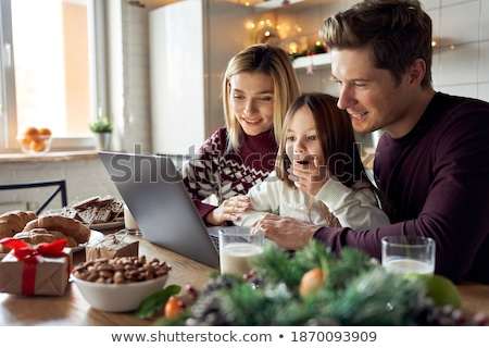 Parents and Little Girl Do Shopping on Christmas Stock photo © robuart