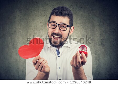 super excited man with red heart shape wedding ring box stock photo © ichiosea