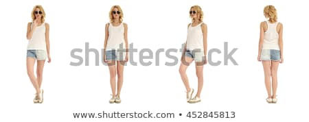 Slim tanned woman's body. Isolated over white background. Stock photo © Nobilior