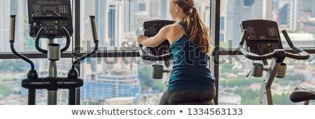 jonge · vrouw · fiets · gymnasium · groot · stad - stockfoto © galitskaya