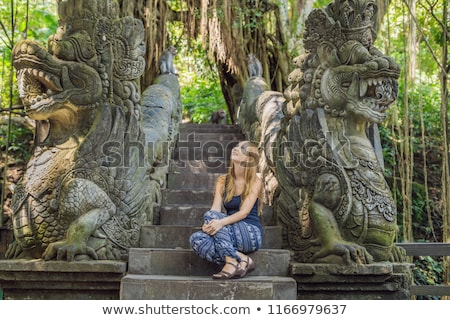 Fiatal nő turista majom erdő Bali Indonézia Stock fotó © galitskaya
