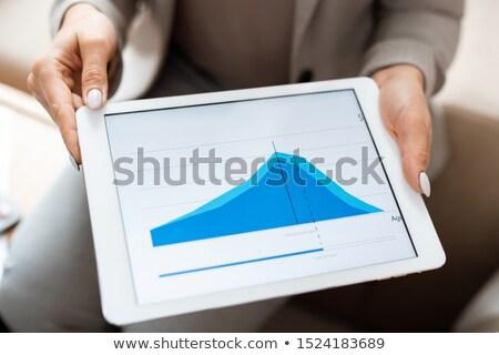 Handen makelaar tablet Blauw financiële Stockfoto © pressmaster