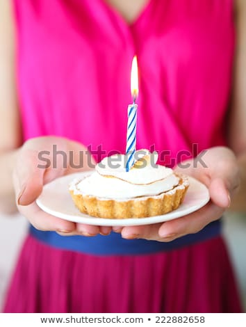 teenage girl with one candle on birthday cupcake Stock photo © dolgachov