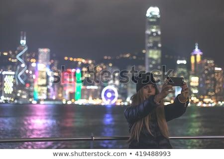 Young woman taking photos of victoria harbor in Hong Kong, China Stock photo © galitskaya