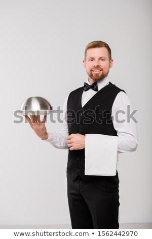 Mutlu genç garson siyah yelek Stok fotoğraf © pressmaster
