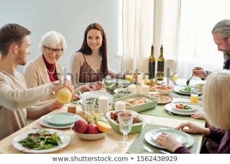 Joven jugo de naranja abuelita familia cena Foto stock © pressmaster