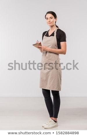 Dość kelnerka fartuch czarny chudy dżinsy Zdjęcia stock © pressmaster