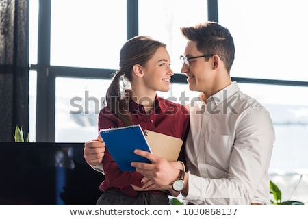 Businesswoman Flirting In Office Stock photo © AndreyPopov