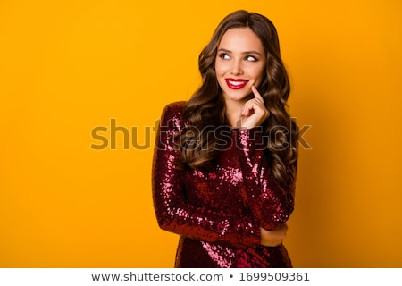Smiling young woman in bright sequins dress Stock photo © deandrobot