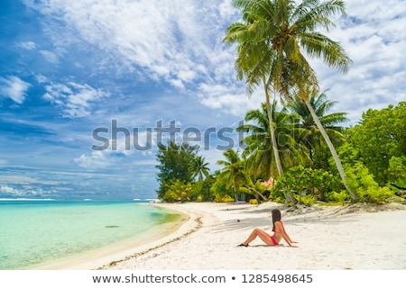 Rahatlatıcı kadın güneşlenme kum plaj bikini Stok fotoğraf © Maridav