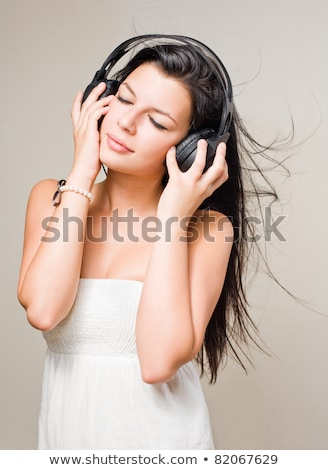 brunette immersed in music wearing headphones stock photo © lithian