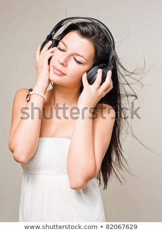 Morena música fones de ouvido jovem Foto stock © lithian