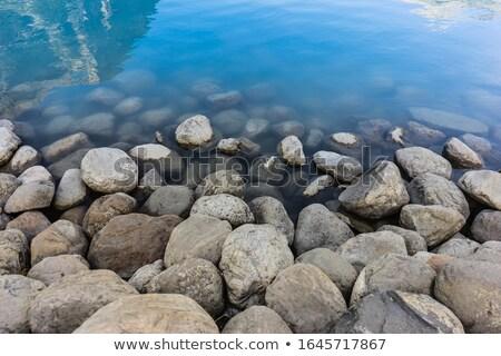 Primer plano rocas agua lago cielo paisaje Foto stock © Sandralise
