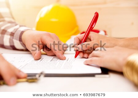 Stock photo: Keys and helmet on building contract