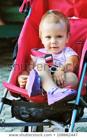 Stock photo: toddler sitting in a pram