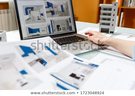 Architect working on a blueprint Stock photo © photography33