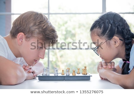 A couple of teenagers playing chess. Stock photo © photography33