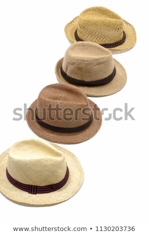 Row of straw hats with ribbons stock photo © backyardproductions