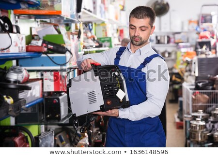 craftsman holding a welding tool and a tool box Stock photo © photography33