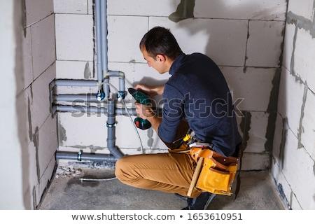 crouching plumber Stock photo © photography33