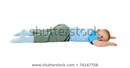Child Stumbled Fell And Lay On White Background Stock fotó © pzAxe