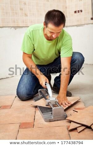 Férfi térdel csempe építkezés ipar munkás Stock fotó © photography33