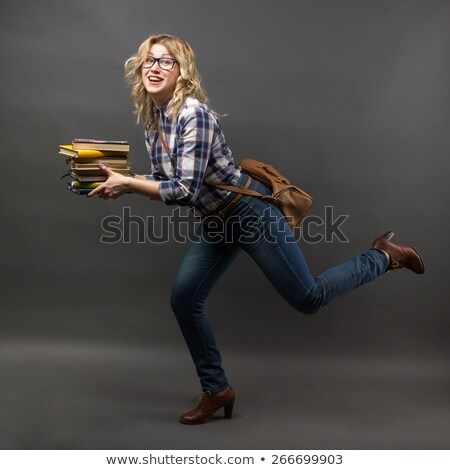 Girl student in hurry to class with a book Stock photo © pzaxe