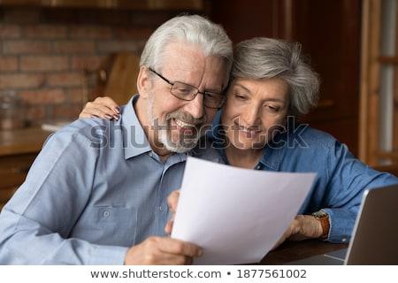 женщину осторожно чтение документа бизнеса бумаги Сток-фото © photography33