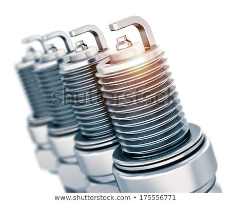 Four spark plugs. Isolated on white. Stock photo © RuslanOmega