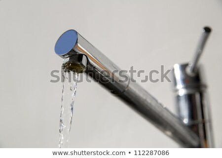 Faucet is opened and release water stream Stock photo © vetdoctor