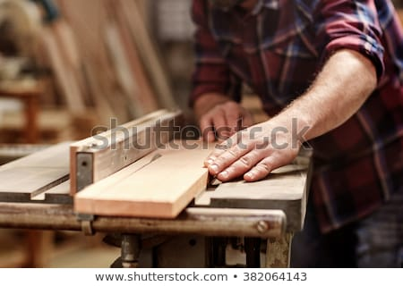 Stock photo: Artisan with plank of wood