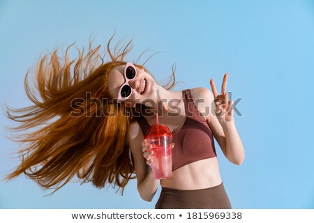 Redhead girl with at sign Stock photo © photography33