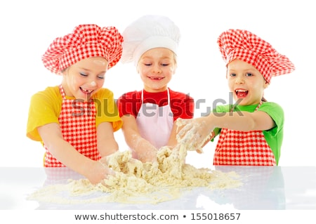 Beautiful girl at tha cake. Stock photo © Massonforstock