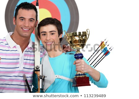 Weinig jongen winnend boogschieten wedstrijd gezicht Stockfoto © photography33