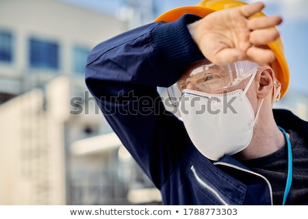 Trabajador de la construcción sudar frente construcción trabajo fondo Foto stock © photography33