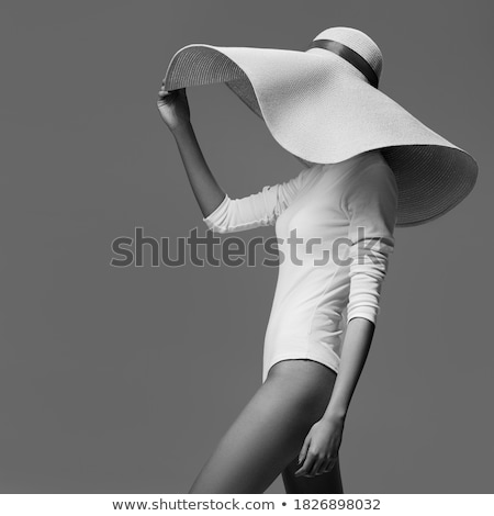 fashion beauty posing with large hat stock photo © carlodapino