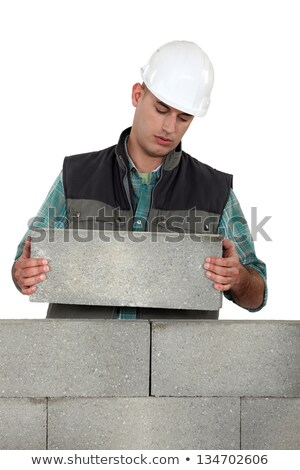 Bored tradesman laying cinder blocks Stock photo © photography33