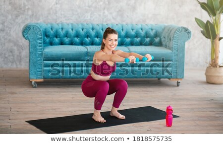 female doing her workout with a dumbbell Stock photo © photography33