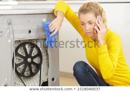plumber on the phone kneeling Stock photo © photography33