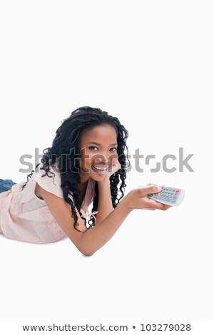 Fiatal lány mosolyog kamera tart televízió távirányító Stock fotó © wavebreak_media