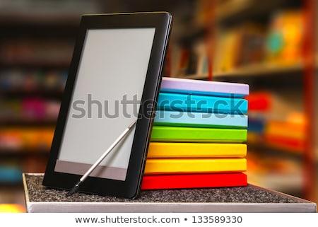 Csetepaté színes könyvek elektronikus könyv olvasó Stock fotó © AndreyKr