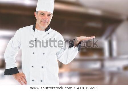 érett szakács néz láthatatlan termék teljes alakos Stock fotó © wavebreak_media