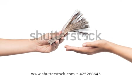 Hand giving dollars banknotes isolated on the white background  Stock photo © luckyraccoon
