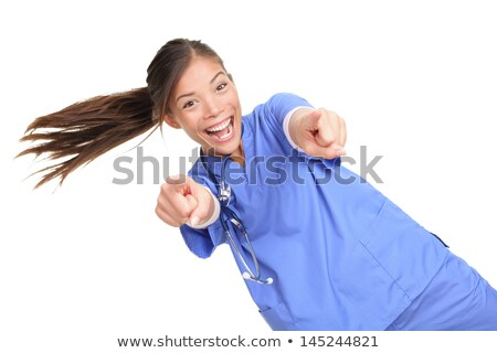 excited female doctor or nuse pointing at you stock photo © maridav