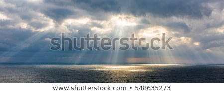 evening landscape with sun and the rays over ocean stock photo © pzaxe