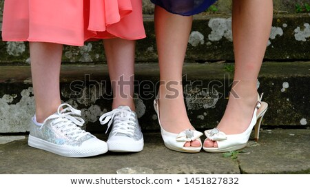 Sneakers and High Heels in Prom Dresses Stock photo © pixelsnap