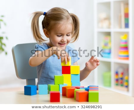 Small Girl playing with construction cubes Stock photo © luckyraccoon