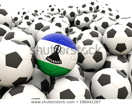 Flag of lesotho with football in front of it Stock photo © MikhailMishchenko