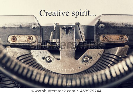 Motive on Old Typewriter's Keys. Stock photo © tashatuvango