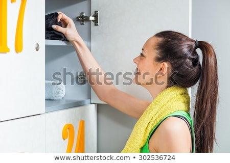 happy woman at gyms locker room stock photo © candyboxphoto
